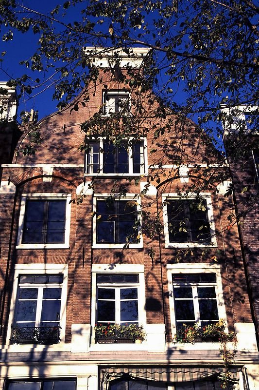 Amsterdam (Oude Waal) canal gable closeup &  blue skies