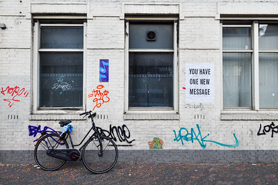 Abandoned bicycle and graffiti