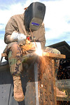 081107-A-2080I-018 GUANTANAMO BAY, Cuba (Nov. 7, 2008) Navy Petty Officer 3rd Class Matthew Long, a steel worker with Naval Mobile Construction Battalion (NMCB) 4, cuts through a metal supp ...