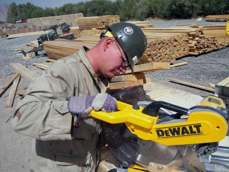 081007-N- 4107C-001 <br /> GHAZNI, Afghanistan (Oct. 7, 2008) Storekeeper Seaman Patrick Joynt cuts lumber during the prefabrication phase of construction for a ÒSuper B-HutÓ while deployed to Afghanistan with Naval Mobile Construction Battalion (NMCB) 4. NMCB-4 is deployed to Kuwait with detachments located in the Ghazni Province of Afghanistan. (U.S. Navy photo by Constructionman Brendan Conaty/Released)
