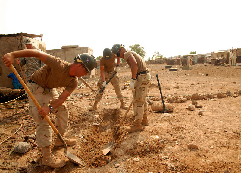 080923-N-3560G-004<br /> NAGAD, Djibouti (Sept. 23, 2008) Seabees assigned to Naval Mobile Construction Battalion (NMCB) 4 dig the foundation for a concrete form during the construction of a new water distribution system. NMCB-4 is building a new water distribution system to separate drinking water from non-potable water. U.S. Navy photo by Mass Communication Specialist 2nd Class Ronald Gutridge/Released)