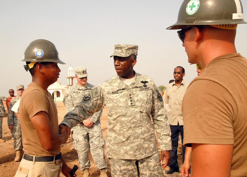 080923-N-3560G-025<br /> CAMP LEMONIER, Djibouti (Sept. 23, 2008) Construction Electrician Constructionman Apprentice Nara Eim, from Naval Mobile Construction Battalion (NMCB) 4, greets General William Ward, commander, United States Africa Command. NMCB-4 is on a six-month deployment supporting Combined Joint Task Force-Horn of Africa. (U.S. Navy photo by Mass Communication Specialist 2nd Class Ronald Gutridge/Released)