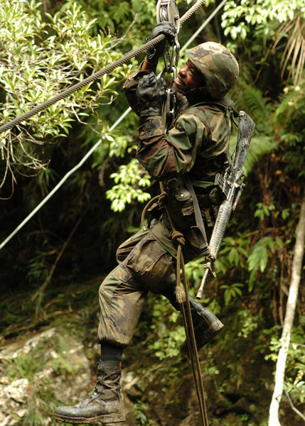 050817-N-1261P-135<br /> Okinawa, Japan (Aug. 17, 2005) - U.S. Navy Hospital Corpsman 2nd Class Danny L. Hawkins slides across a river using a pulley system as part of an obstacle course at the Jungle Warfare Training Center (JWTC), located in the Northern Training Area on the island of Okinawa. Petty Officer Hawkins is assigned to Naval Mobile Construction Unit Seven Four (NMCB-74). U.S. Navy photo by Photographer's Mate 2nd Class Eric S. Powell (RELEASED)