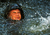 050817-N-1261P-052<br /> Okinawa, Japan (Aug. 17, 2005) - U.S. Navy Gunner's Mate 3rd Class James M. Mikulec swims through a culvert that is part of a 3.8 mile obstacle course at the Jungle Warfare Training Center (JWTC), located in the Northern Training Area on the island of Okinawa. Petty Officer Mikulec is assigned to Naval Mobile Construction Unit Seven Four (NMCB-74). U.S. Navy photo by Photographer's Mate 2nd Class Eric S. Powell (RELEASED)