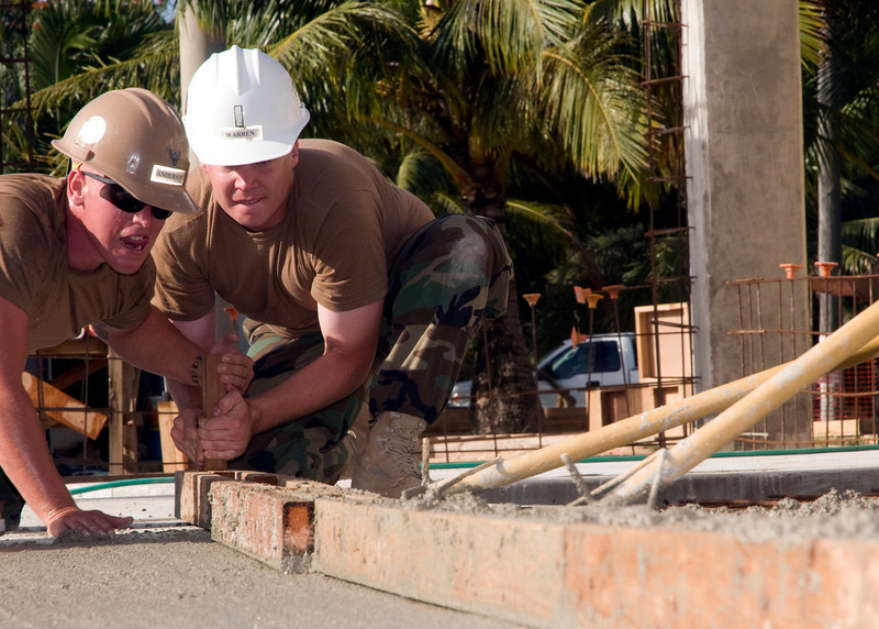090219-N-4928B-012<br /> NAVAL BASE GUAM (Feb. 19, 2009) Steelworker 3rd Class Andrew Anderson, left and Ens. Michael Warren, right, assigned to Naval Mobile Construction Battalion (NMCB) 40 work together to smooth concrete at Naval Base Guam's fuel farm. NMCB-40 is deployed throughout the Pacific Command's area of responsibility to provide construction support to area commanders. (U.S. Navy photo by Chief Mass Communication Specialist Anthony Briggs Jr./Released)