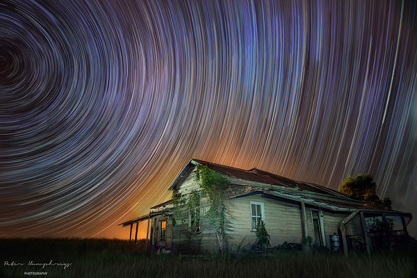 Moving stars over old farm house.