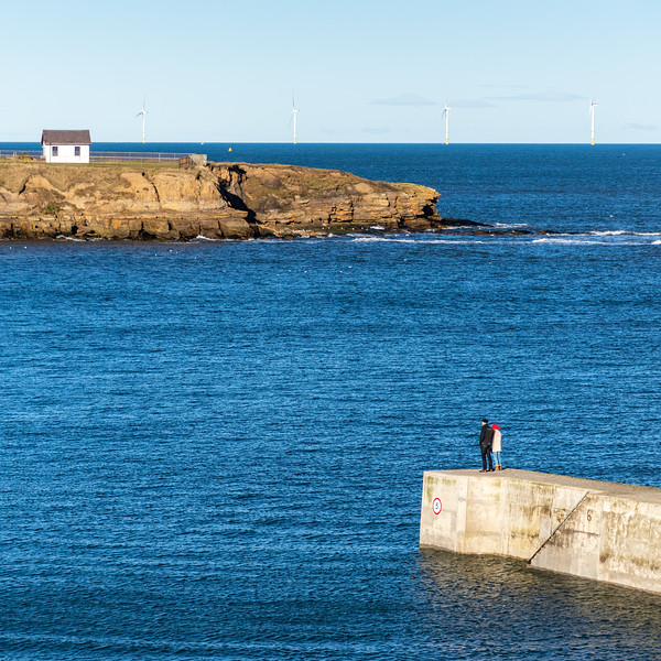 Walking on Cullercoats Harbour wall