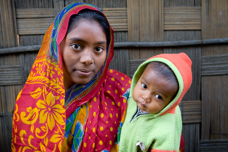 Mother and child. Daushuar, a small village near Kaziranga. Assam.
