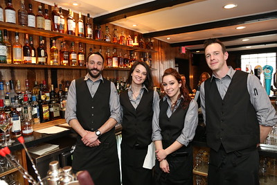 At the bar in The North House Restaurant are, from left, Dan Phelan of Collinsville, Jessica Cunningham of Deep River, Marissa Napoletano of Hartford and Travis Fortier of West Hartford.  Photo by John Fitts