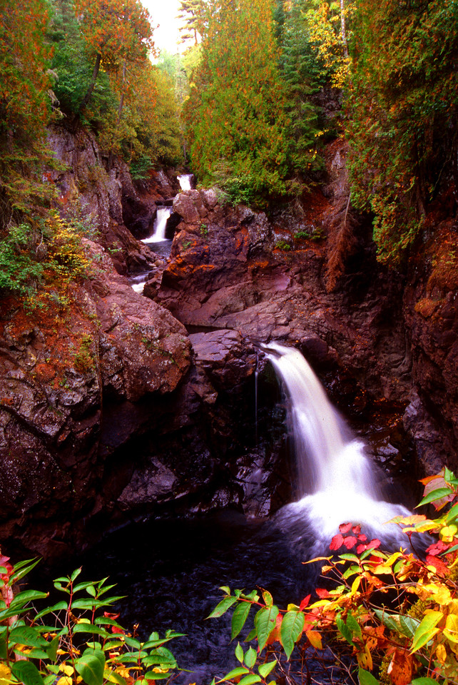 """""""Cascade Falls Gorge"""". Taken during the peak fall colors in September of 1997 during a very dry fall. This scene no longer exists and a fence was placed where bush are in the foreground. Taken with a Nikon FG film camera and Fuji velvia slide film"""