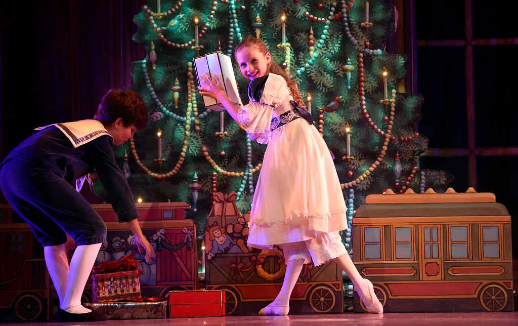 . BOULDER, CO - NOVEMBER 29, 2018: Child Clara, played by Audrey Philpott, shakes a Christmas present during a rehearsal for a sensory-sensitive version of The Nutcracker on Thursday night at Skyline High School in Longmont. The performance is by the Boulder Ballet and the Longmont Symphony. For more photos of the rehearsal go to dailycamera.com (Photo by Jeremy Papasso/Staff Photographer)
