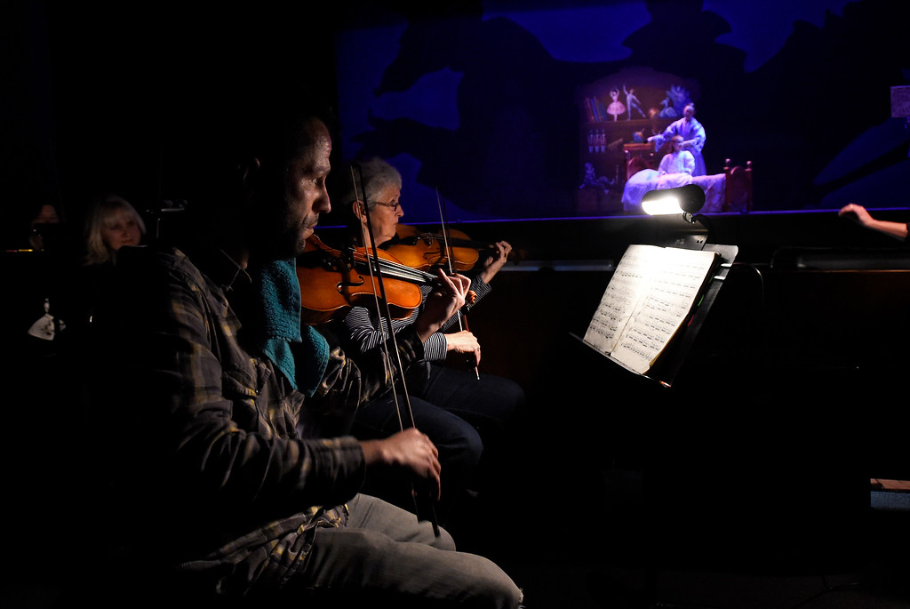 . BOULDER, CO - NOVEMBER 29, 2018: Delcho Tenev, left, and Martha Dicks, performing with the Longmont Symphony, play the violin during a sensory-sensitive rehearsal for The Nutcracker on Thursday night at Skyline High School in Longmont. The performance is by the Boulder Ballet and the Longmont Symphony. For more photos of the rehearsal go to dailycamera.com (Photo by Jeremy Papasso/Staff Photographer)