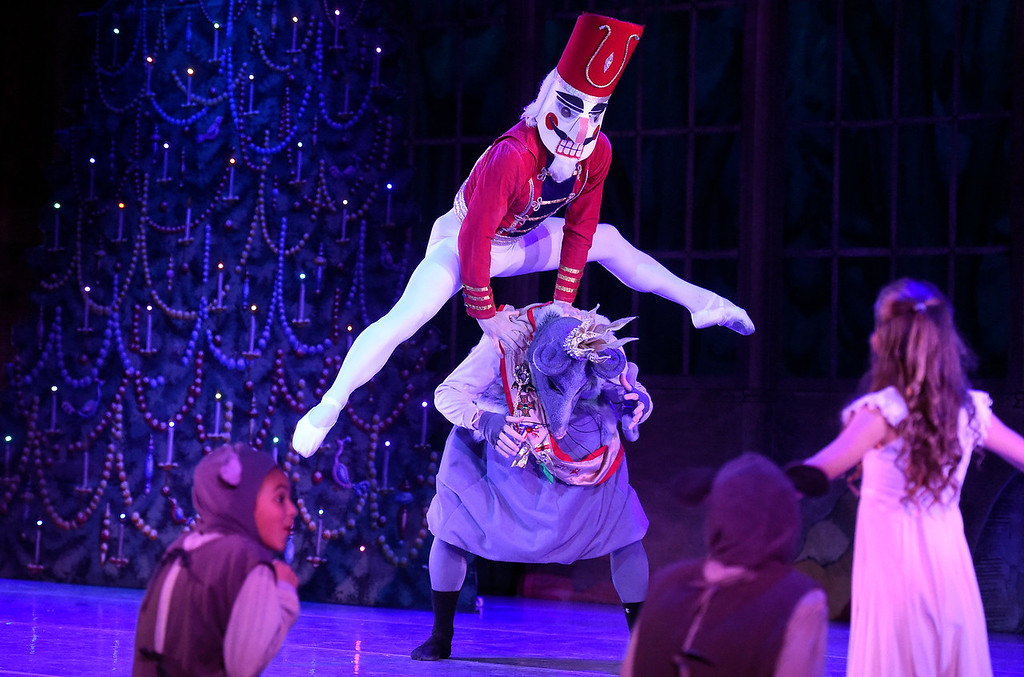. BOULDER, CO - NOVEMBER 29, 2018: The Nutcracker Prince, played by Ryland Early jumps over the Rat King, played by Case Bodamer, during a rehearsal for a sensory-sensitive version of The Nutcracker on Thursday night at Skyline High School in Longmont. The performance is by the Boulder Ballet and the Longmont Symphony. For more photos of the rehearsal go to dailycamera.com (Photo by Jeremy Papasso/Staff Photographer)