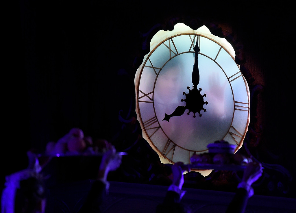 . BOULDER, CO - NOVEMBER 29, 2018: A face peeks through the clock during a rehearsal for a sensory-sensitive version of The Nutcracker on Thursday night at Skyline High School in Longmont. The performance is by the Boulder Ballet and the Longmont Symphony. For more photos of the rehearsal go to dailycamera.com (Photo by Jeremy Papasso/Staff Photographer)