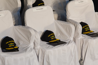 Designated seats for Dr. Jill Biden, and grandson Hunter Biden with hats emblazoned with USS Delaware SSN 791 for the keel laying ceremony