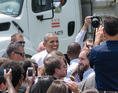 Obama flashes that big smile again.