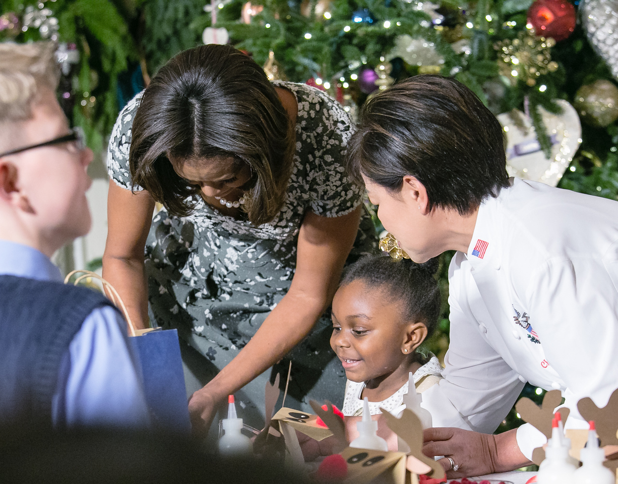 The children are treated to arts, crafts and holiday treats in the White House State Dinning Room on December 4, 2013