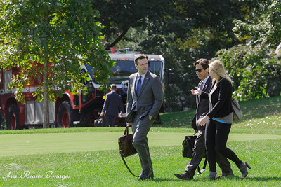 White House Press Secretary Josh Ernest, Joe Paulson and Kristie Canegallo walk to board Marine One.