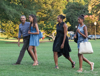 The First Family Strolls Across the South Lawn of the White House