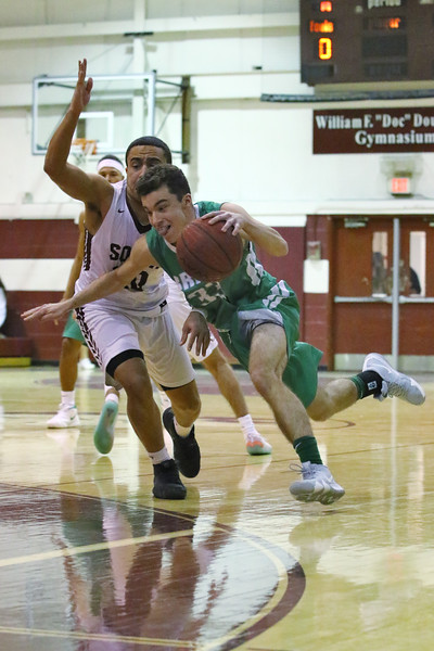 Rob Guerra from Brick tries to get around Jalen Folsom from TRS as Brick Township High School takes on Toms River South High School in a boys varsity basketball game held in Toms River on January 3,2019. (MARK R. SULLIVAN /THE OCEAN STAR)