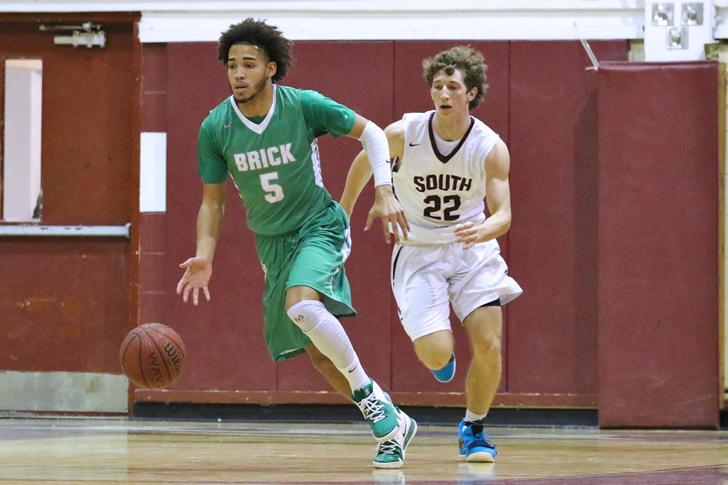 Shane William (left) from Brick heads up court after grabbing a Toms River South rebound as Brick Township High School takes on Toms River South High School in a boys varsity basketball game held in Toms River on January 3,2019. (MARK R. SULLIVAN /THE OCEAN STAR)