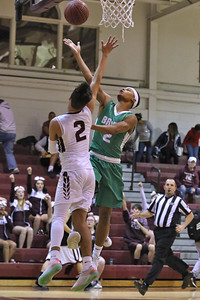 Jalen Jackson from Brick gets around Nick Lusngo from Toms River South as Brick Township High School takes on Toms River South High School in a boys varsity basketball game held in Toms River on January 3,2019. (MARK R. SULLIVAN /THE OCEAN STAR)