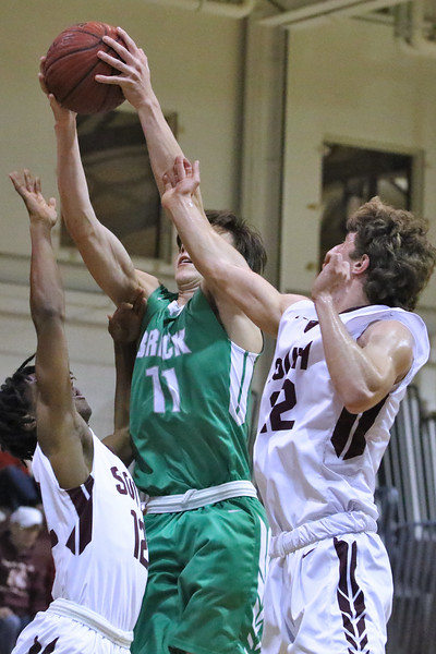 Jack Melone (center) from Brick battles Toms River South defenders for a rebound as Brick Township High School takes on Toms River South High School in a boys varsity basketball game held in Toms River on January 3,2019. (MARK R. SULLIVAN /THE OCEAN STAR)