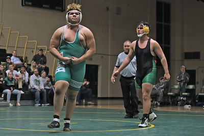 Dayna Andrews of Brick takes on Michael Feliz of Brick Memorial during their HWT lb bout as Brick Memorial High School hosted Brick Township High School for a boys varsity wrestling match on Tuesday Jan. 8,2019 (MARK R. SULLIVAN /THE OCEAN STAR)