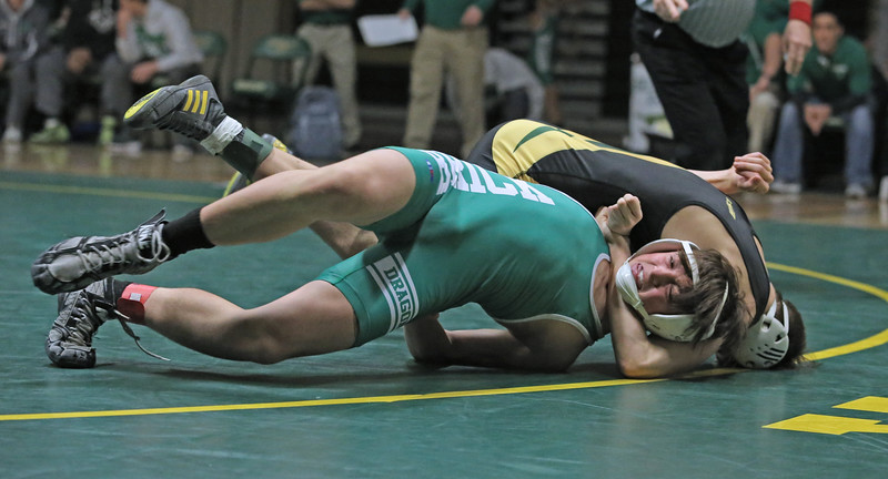 Riley Bellof Brick takes on Mike Richardson of Brick Memorial during their 126 lb bout as Brick Memorial High School hosted Brick Township High School for a boys varsity wrestling match on Tuesday Jan. 8,2019 (MARK R. SULLIVAN /THE OCEAN STAR)
