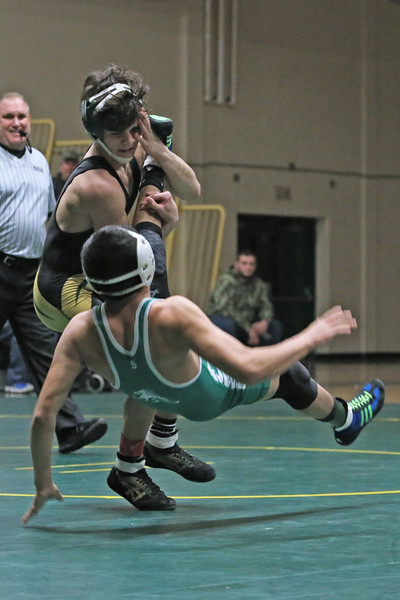 Hugo Hernandez of Brick takes on Vincent Santaniello of Brick Memorial during their 120 lb bout as Brick Memorial High School hosted Brick Township High School for a boys varsity wrestling match on Tuesday Jan. 8,2019 (MARK R. SULLIVAN /THE OCEAN STAR)