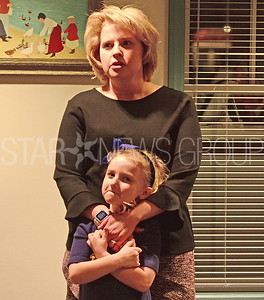 re-sworn in member jennifer barnes-gambert saying her thank yous with her daughter