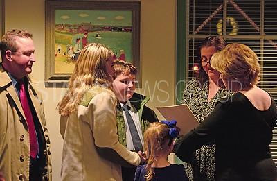 councilmember jennifer barnes-gambert being re-sworn in joined by her family.