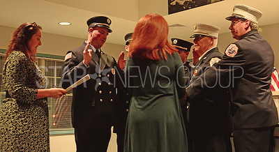 the newly promoted bhfd members and their family member being sworn in