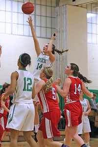 Emma Carpino (center) from Brick gets above everyone for the jump shot as Brick Township High School hosted Jackson Liberty High School in a girls varsity basketball game on Thursday Jan. 24, 2019. (MARK R. SULLIVAN/THE OCEAN STAR)