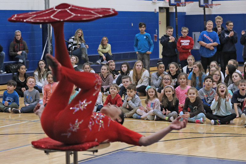 Acrobat Li Liu wows the crowds with her hand balancing during her show for students at the Bay Head Elementary School in Bay Head on Friday Feb. 1, 2019.  (MARK R. SULLIVAN/THE OCEAN STAR)