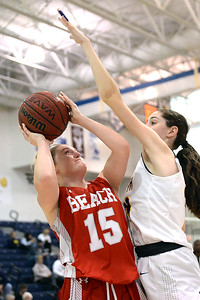 #15, Cassidy Burns of the Point Pleasant Beach Garnet Gulls takes a shot in the game against Toms River North High School on 02/12/2019. (STEVE WEXLER/THE OCEAN STAR).