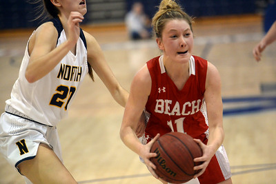 #11, Carleigh Burns of the Point Pleasant Beach High School Girl's Varsity Basketball Team drives the lane towards the basket in the game against Toms River North High School on 02/12/2019. (STEVE WEXLER/THE OCEAN STAR).