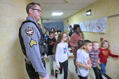 Sgt. Zachery Keller (left) from Bay Head watches students respond as police officers from the Bay Head and Point Pleasant Beach departments were on hand with the Lavallette Police department for a ALICE training session at the Lavallette Elementary School on Thursday Feb. 14, 2019. (MARK R. SULLIVAN/THE OCEAN STAR)