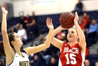 #15, Cassidy Burns of the Point Pleasant Beach High School Girl's Varsity Basketball Team takes a shot in the game against Toms River North High School on 02/12/2019. (STEVE WEXLER/THE OCEAN STAR).