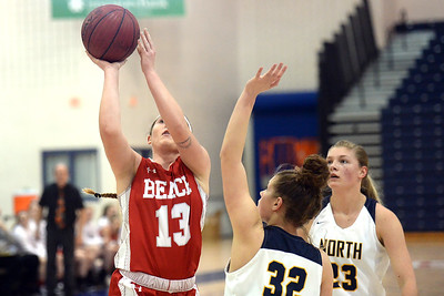 #13, Madelyn House of the Point Pleasant Beach Garnet Gulls takes a shot in the game against Toms River North High School on 02/12/2019. (STEVE WEXLER/THE OCEAN STAR).