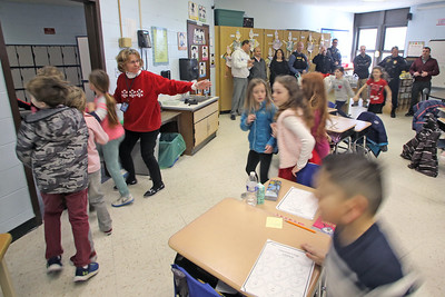 Students run thru a active shooter drill as police officers from the Bay Head and Point Pleasant Beach departments were on hand with the Lavallette Police department for a ALICE training session at the Lavallette Elementary School on Thursday Feb. 14, 2019. (MARK R. SULLIVAN/THE OCEAN STAR)