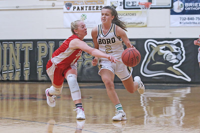 All House (left) knocks the ball away from Allie Delaney (right) as Point Pleasant Borough High School hosted cross town rival Point Pleasant Beach in a girls varsity basketball game on Friday Feb. 22, 2019. (MARK R. SULLIVAN /THE OCEAN STAR)