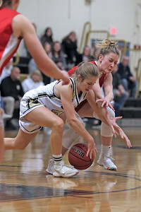 Annalise Albarano (left) battles with Carleigh Burns for control of a loose ball as Point Pleasant Borough High School hosted cross town rival Point Pleasant Beach in a girls varsity basketball game on Friday Feb. 22, 2019. (MARK R. SULLIVAN /THE OCEAN STAR)