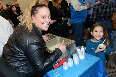 Vanessa Berrios of Atlantic Offshore Fisheries serves their soup entry to a happy 6 year old Sofia Bezerra at the Point Pleasant Beach Chamber of Commerce sponsored Soup Cook Off. (STEVE WEXLER/THE OCEAN STAR).