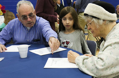 "Courtney Serrano [center] with her grandfather, John Moore and great-grandmother, Francis Devaney. Bay Head Elementary School's ""Grandfriends Day"" event in Bay Head, NJ on 2/21/19. [DANIELLA HEMINGHAUS 