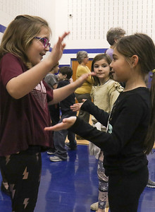 "Chloe Disbrow (left) playing with Taylor Badders (right) and Eevi Webb (center). Bay Head Elementary School's ""Grandfriends Day"" event in Bay Head, NJ on 2/21/19. [DANIELLA HEMINGHAUS 