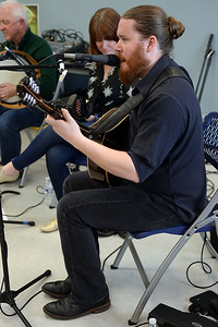 "Max Carmichael of the Celtic band ""Daoine"" sings a traditional Gaelic Irish tune while playing the Bouzouki at their performance at the Ocean County Library, Brick Branch on 03/09/2019. (STEVE WEXLER/THE OCEAN STAR)."