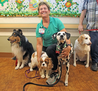 After 38 years of service at the Claremont Center in Point Pleasant Borough, Loni Hulse is stepping down as the Recreation Therapy Director. Here Hulse enjoying time with local therapy dogs that visit the center from time to time. (MARK R. SULLIVAN /THE OCEAN STAR)