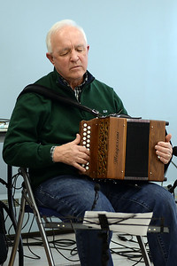 "Joe Dunne of the traditonal Celtic band ""Daoine"" plays his Irish Button Accordian during a performance at the Ocean County Library, Brick Branch on 03/09/2019. (STEVE WEXLER/THE OCEAN STAR)."
