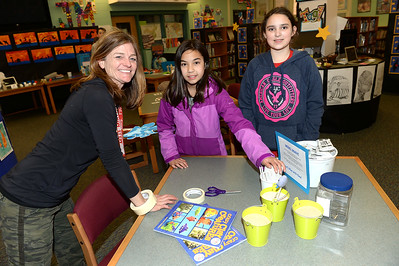Ms. Kim Carr stands in with her Antrim School students, Elena Percelay, 4th grade and Claire Ruddy, 3rd grade, at their Modeling Clay exhibit, during the Innovation Fair on 03/14/2019. (STEVE WEXLER/THE OCEAN STAR).